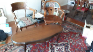 Antique wood and upholstered armchairs and coffee table