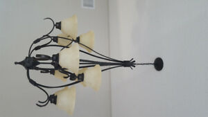 Chandelier - 9 lights.  Bronze with antique glass shades.