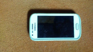 GTS7560M Samsung Smartphone with charger and case. New condition