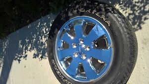 """Jeep Chrome rims with 18"""" Good Year Fortera tires"""