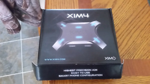 Xim4 mouse and keyboard console adapter