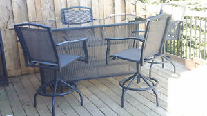 Outdoor glass/steel bar with 4 matching swivel chairs