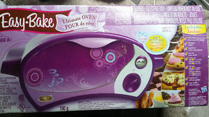 Easy Bake Oven with extra molds - Like new. Only used 2x