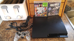 PS3 Slim With 320 GB Hard Drive, Wireless Controller And GTA 5.