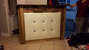 Solid wood headboard.