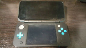 Used *New* 2ds XL Turquoise With Box Charger Stylus and 2 games.