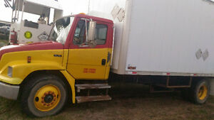 Freightliner FL70 20 foot van body with tailgate lift