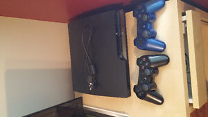 PS3 Slim 111 GB (2 dualshock controllers and 18 games)