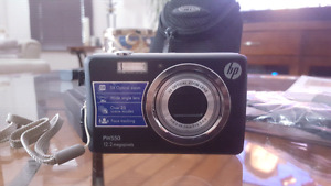 HP 12.2 megapixel camera with 4gb SD card and case.