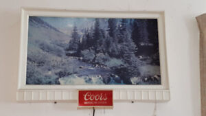 Antique lighted Coors Beer sign.