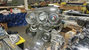 two 1956 Cadillac hubcaps