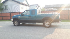 Ford F250 Lariat ext cab 4x4 with work canopy $4400 O.B.O.