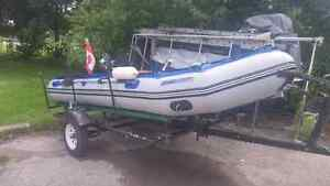 Inflatable boat+2 motors+trailer and more