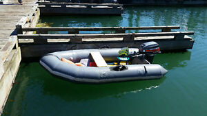 8 ft fiberglass bottom inflateable zodiac. will trade motorcycle