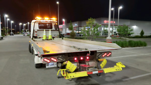 Long distance flatbed towing