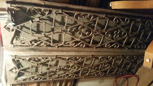 2 wooden doors with special iron work.