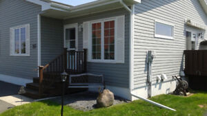 Like new condition End unit Garden home east 2+1 bedrooms