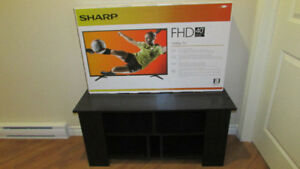 New-in-box, 40-inch LED TV with FREE entertainment stand