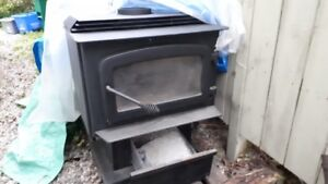 Two Woodstoves for sale! Large and smaller Size ,also chromepipe