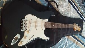 Squier strat in good shape and a epiphone valve junior