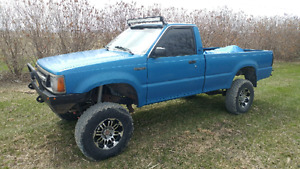 "1987 Mazda B2600 4x4 with SAS and 7"" lift"