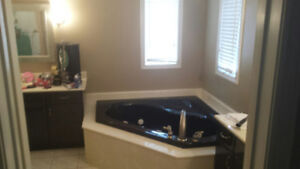 Black Jacuzzi Tub and Faucet