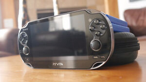 PS Vita + 3 4GB Memory Cards + 2 Games & Carrying Case