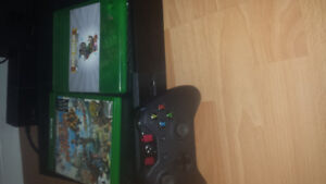 Xbox 1 . 500 gig console with controller cords and 2 games.