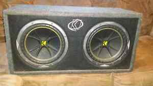 """Two 10"""" kicker comps in box with a kicker amp and cords"""