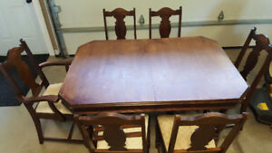Antique dining table with 6 chairs