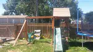 Swing set with play center
