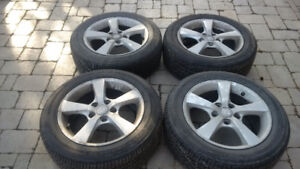 Four Firestone Champion Tires on Rims for Sale