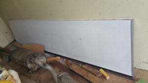 Garage door panel ( 9 ft. X 2 ft. ) new