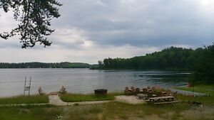Munroe Lake. 1400' of Sandy Beach Property