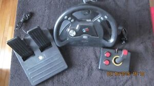 Playstation Mad Catz Wheel & Foot Pedals & Controller London Ontario image 1