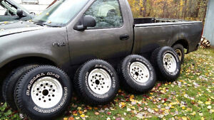 4 tires and rims and truck for parts