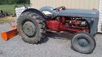 Ford 9N tractor with  blade and tire chains