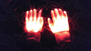 White cotton gloves with red LED lights