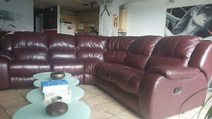 Large burgundy leather recliner sectional couch