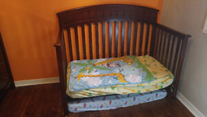 Graco convertible crib with bedding and 1 mattress