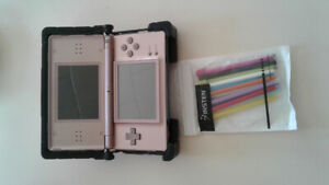Coral pink nintendo ds lite with lots of games and accessories