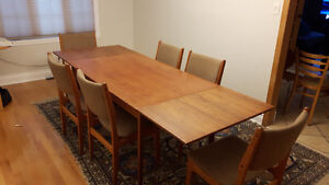 Findahl Teak dining room table and 6 matching chairs. Seats 10