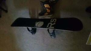 Rossignol snowboard with bindings and boots