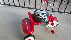 Radio flyer tricycle and helmet