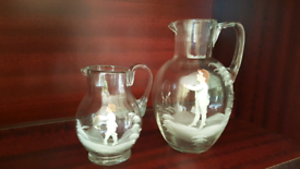 Mary Gregory glass jugs