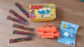 Vintage Smurf slide projector set & new swimming bath toy smurfs