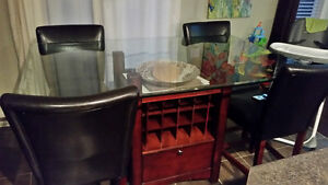 Bar height glass dining table with 4 parsons chairs