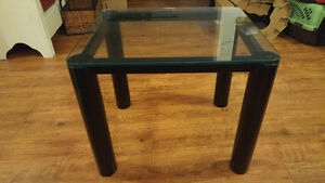 Sturdy, glass top end table.