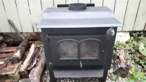Small woodstove 1200sq $250 and Large $500  1800 Sq feet