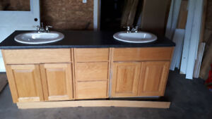 Oak face upper and lower cabinets with lights and mirror taps si